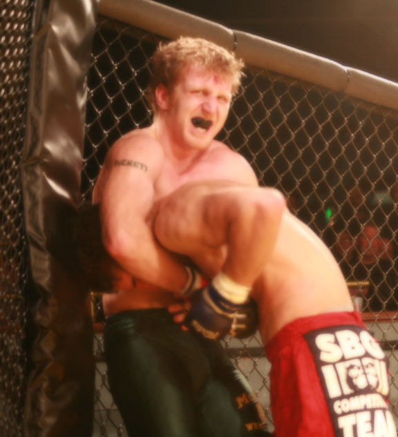 Andy Pickett on the Cage at Rumble at The Roseland