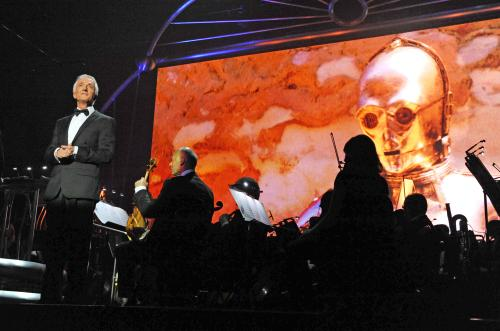 Actor Anthony Daniels narrates a portion of the story from the films onstage during Star Wars™: In Concert.