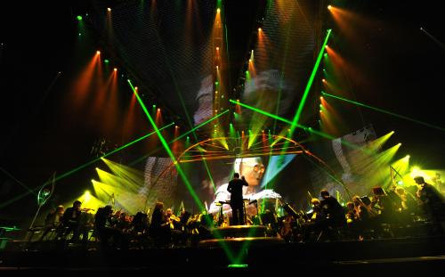 C-3PO onscreen with lights and lasers during Star Wars™: In Concert.